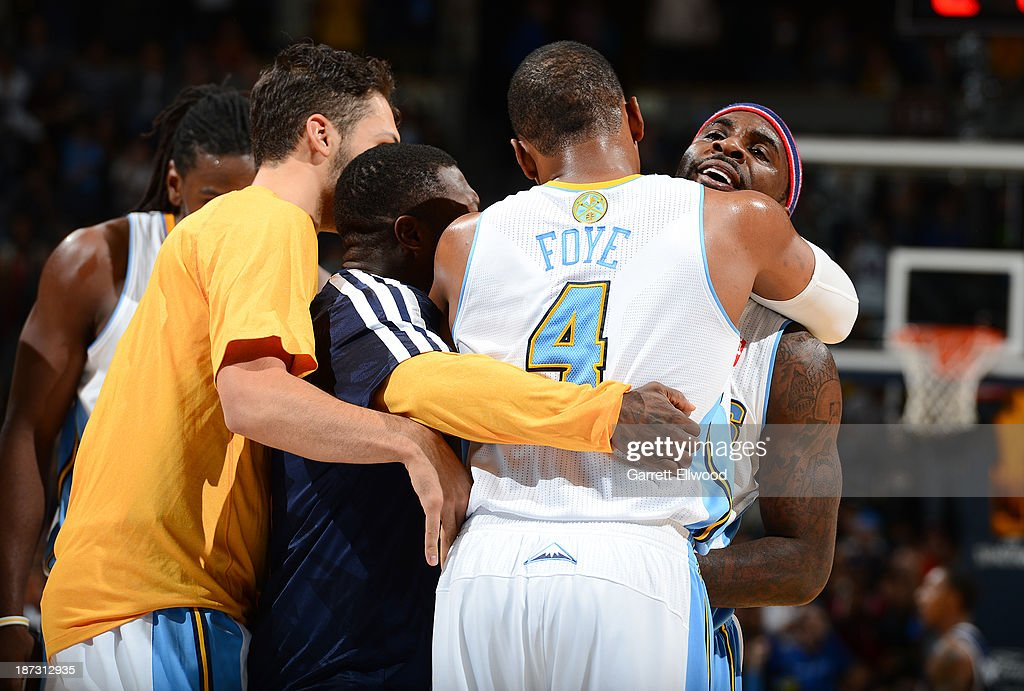 Randy Foye #4 of the Denver Nuggets hugs his teammates after the game against the Atlanta Hawks on November 7, 2013 at the Pepsi Center in Denver, Colorado.