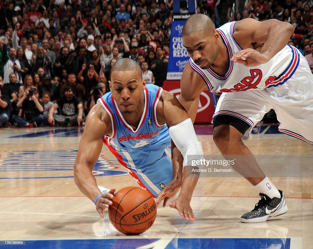 <a gi-track='captionPersonalityLinkClicked' href=/galleries/search?phrase=Randy+Foye&family=editorial&specificpeople=240185 ng-click='$event.stopPropagation()'>Randy Foye</a> #4 of the Los Angeles Clippers battles for the loose ball against <a gi-track='captionPersonalityLinkClicked' href=/galleries/search?phrase=Gary+Neal&family=editorial&specificpeople=5085165 ng-click='$event.stopPropagation()'>Gary Neal</a> #14 of the San Antonio Spurs at Staples Center on February 18, 2012 in Los Angeles, California.