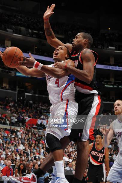 Randy Foye of the Los Angeles Clippers has his shot challenged by Marcus Camby of the Portland Trail Blazers at Staples Center on October 27 2010 in...