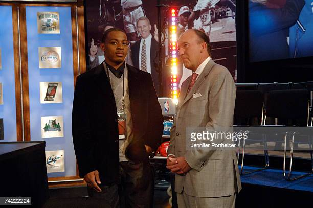 Randy Foye of the Minnesota Timberwolves speaks with Mike Dunleavy Head Coach of the Los Angeles Clippers prior to the 2007 NBA Draft Lottery on May...