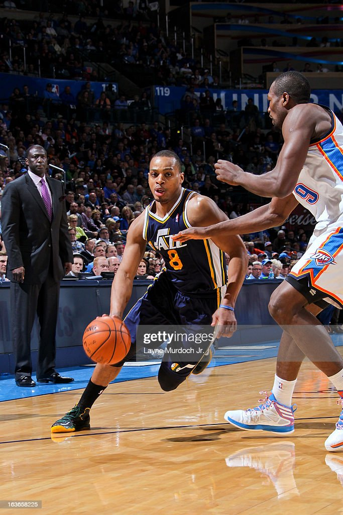 Randy Foye #8 of the Utah Jazz drives against Serge Ibaka #9 of the Oklahoma City Thunder on March 13, 2013 at the Chesapeake Energy Arena in Oklahoma City, Oklahoma.