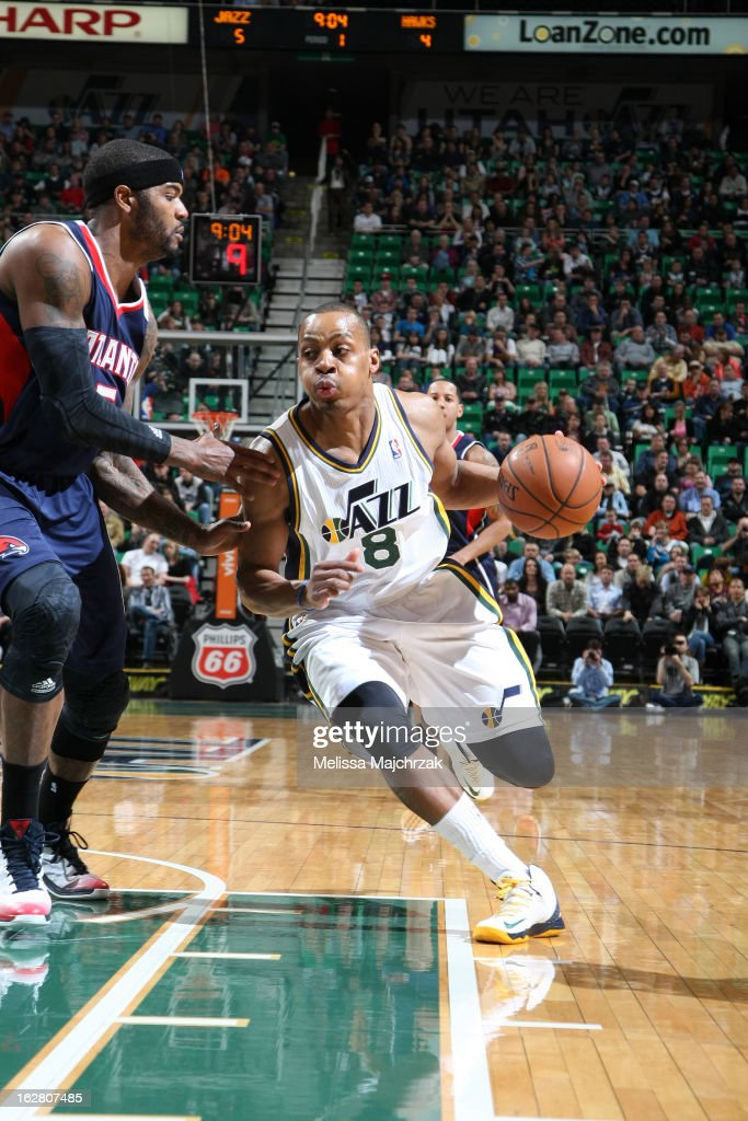 Randy Foye #8 of the Utah Jazz drives to the hoop against Josh Smith #5 of the Atlantic Hawks at Energy Solutions Arena on February 27, 2013 in Salt Lake City, Utah.