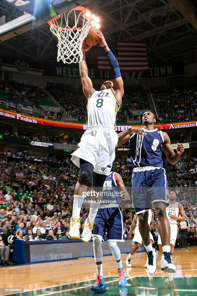 Randy Foye #8 of the Utah Jazz dunks against Serge Ibaka #9 of the Oklahoma City Thunder at Energy Solutions Arena on February 12, 2013 in Salt Lake City, Utah.