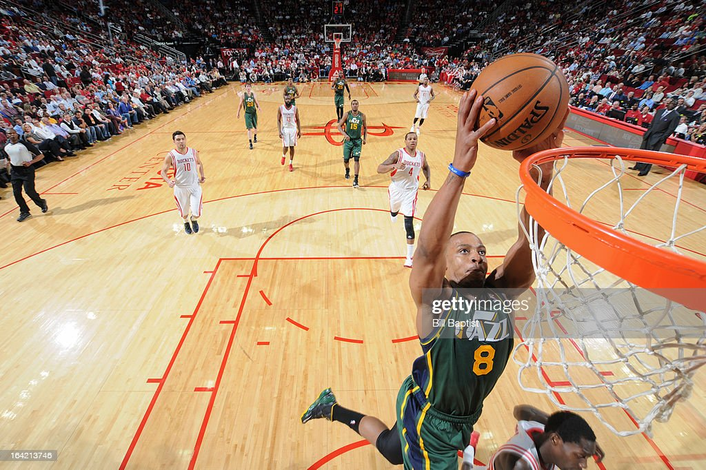 <a gi-track='captionPersonalityLinkClicked' href=/galleries/search?phrase=Randy+Foye&family=editorial&specificpeople=240185 ng-click='$event.stopPropagation()'>Randy Foye</a> #8 of the Utah Jazz dunks the ball on a fast break against the Houston Rockets on March 20, 2013 at the Toyota Center in Houston, Texas.