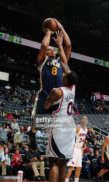 Randy Foye of the Utah Jazz goes up for the shot against Jeff Teague of the Atlanta Hawks on January 11 2013 at Philips Arena in Atlanta Georgia NOTE...