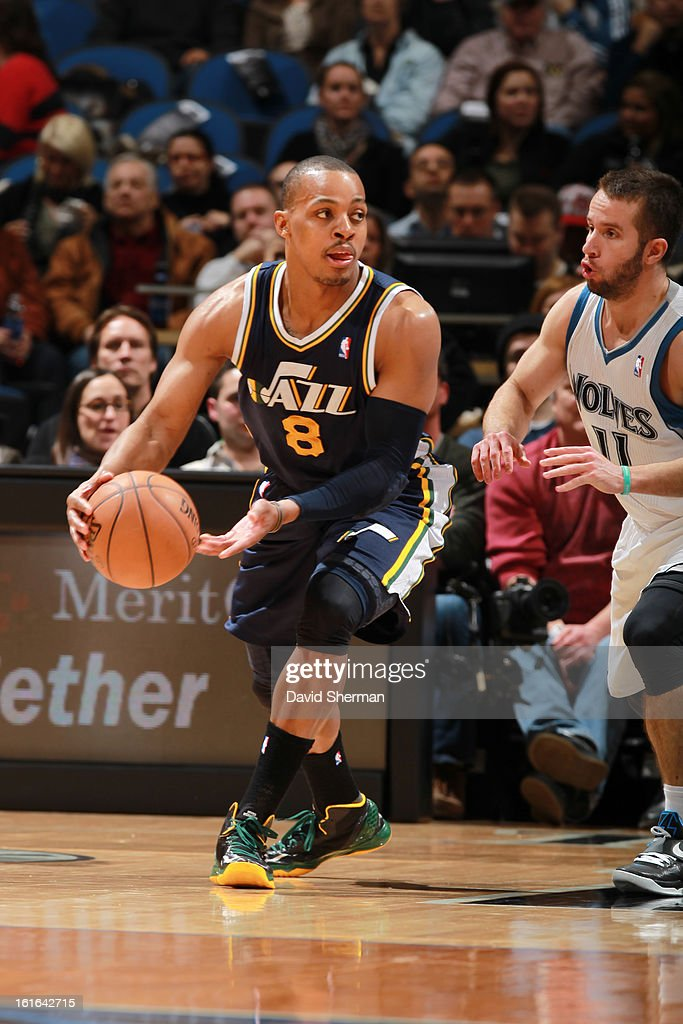Randy Foye #8 of the Utah Jazz looks to pass the ball against J.J. Barea #11 of the Minnesota Timberwolves on February 13, 2013 at Target Center in Minneapolis, Minnesota.