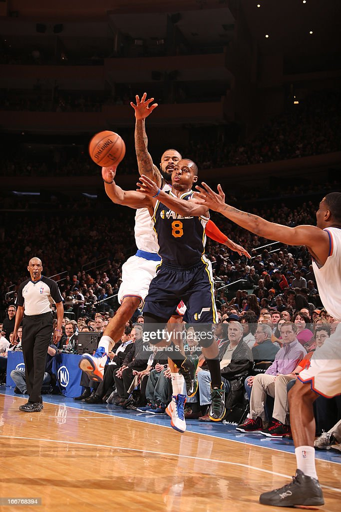 <a gi-track='captionPersonalityLinkClicked' href=/galleries/search?phrase=Randy+Foye&family=editorial&specificpeople=240185 ng-click='$event.stopPropagation()'>Randy Foye</a> #8 of the Utah Jazz passes the ball against <a gi-track='captionPersonalityLinkClicked' href=/galleries/search?phrase=Tyson+Chandler&family=editorial&specificpeople=202061 ng-click='$event.stopPropagation()'>Tyson Chandler</a> #6 of the New York Knicks on March 8, 2013 at Madison Square Garden in New York City.