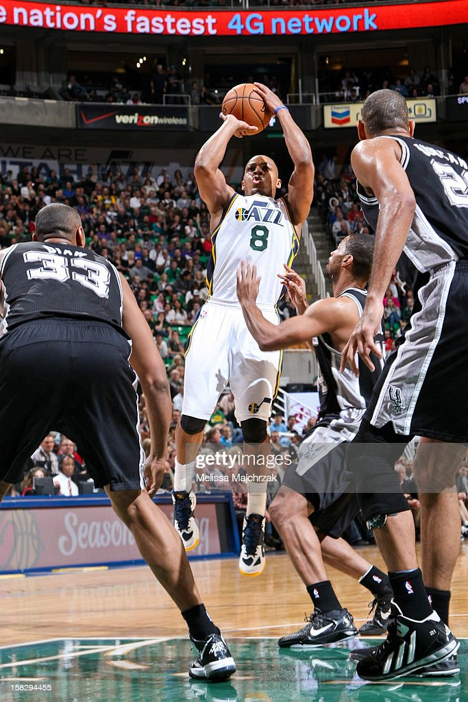 <a gi-track='captionPersonalityLinkClicked' href=/galleries/search?phrase=Randy+Foye&family=editorial&specificpeople=240185 ng-click='$event.stopPropagation()'>Randy Foye</a> #8 of the Utah Jazz shoots against <a gi-track='captionPersonalityLinkClicked' href=/galleries/search?phrase=Boris+Diaw&family=editorial&specificpeople=201505 ng-click='$event.stopPropagation()'>Boris Diaw</a> #33 and <a gi-track='captionPersonalityLinkClicked' href=/galleries/search?phrase=Gary+Neal&family=editorial&specificpeople=5085165 ng-click='$event.stopPropagation()'>Gary Neal</a> #14 of the San Antonio Spurs at Energy Solutions Arena on December 12, 2012 in Salt Lake City, Utah.