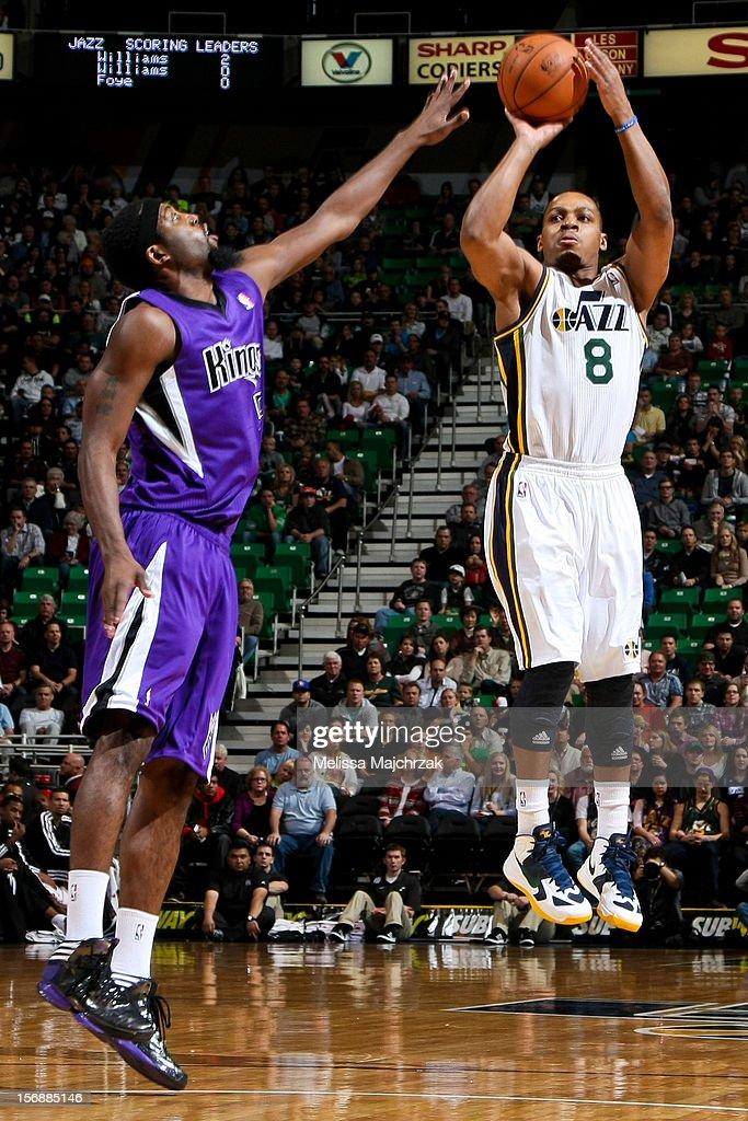 Randy Foye #8 of the Utah Jazz shoots against John Salmons #5 of the Sacramento Kings at Energy Solutions Arena on November 23, 2012 in Salt Lake City, Utah.