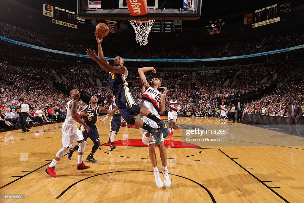 <a gi-track='captionPersonalityLinkClicked' href=/galleries/search?phrase=Randy+Foye&family=editorial&specificpeople=240185 ng-click='$event.stopPropagation()'>Randy Foye</a> #8 of the Utah Jazz shoots against <a gi-track='captionPersonalityLinkClicked' href=/galleries/search?phrase=Nicolas+Batum&family=editorial&specificpeople=3746275 ng-click='$event.stopPropagation()'>Nicolas Batum</a> #88 of the Portland Trail Blazers on March 29, 2013 at the Rose Garden Arena in Portland, Oregon.