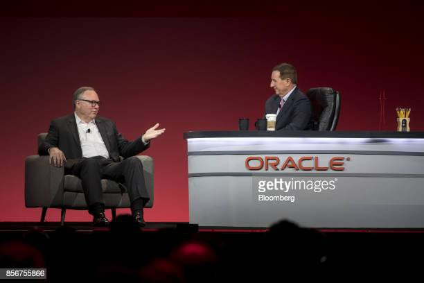 Randy Furr chief financial officer of Bloom Energy Corp left speaks as Mark Hurd chief executive officer of Oracle Corp listens during the Oracle...