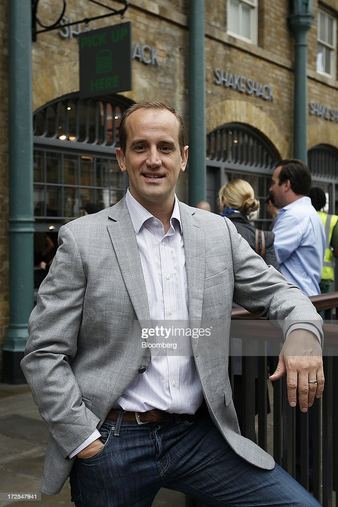 Randy Garutti, chief executive officer of Shake Shack, poses for a photograph outside the company's new burger restaurant in London, U.K., on Tuesday, July 2, 2013. Shake Shack, opening in London's Covent Garden this week, started as a hotdog cart in New York's Madison Square Park, and has outlets in six U.S. states as well as in the Middle East and Turkey. Photographer: Simon Dawson/Bloomberg via Getty Images