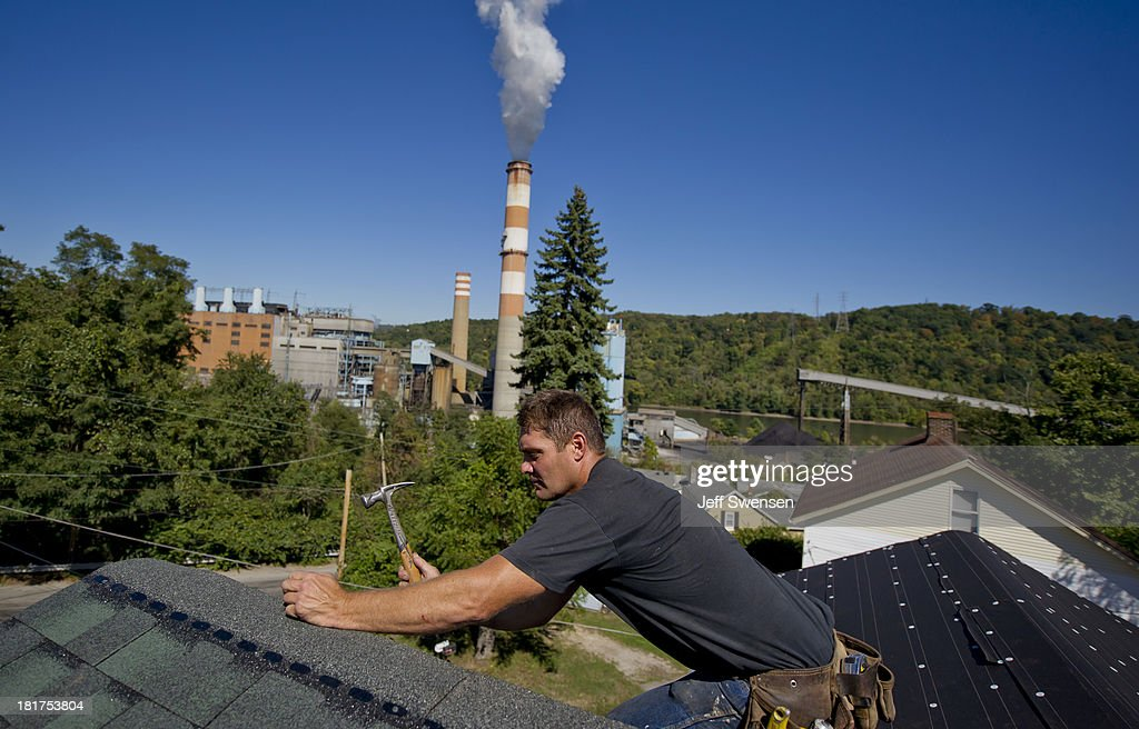 Randy Geracitano, 46, remodels a home up the hill from the Mitchell Power Station, a coal-fired power plant built along the Monongahela River, 20 miles southwest of Pittsburgh, on September 24, 2013 in New Eagle, Pennsylvania. The plant, owned by FirstEnergy, will be one of two plants in the region to be shut down, affecting 380 employees. The Evironmental Protection Agency (EPA) and the Obama administration have been taking major steps to get coal-fired power plants into compliance with clean air regulations.
