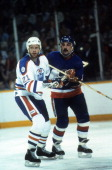 Randy Gregg of the Edmonton Oilers defends against Bryan Trottier of the New York Islanders during the 1984 Stanley Cup Finals in May 1984 at the...