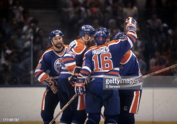 Randy Gregg Pat Hughes Don Jackson and Dave Hunter of the Edmonton Oilers celebrate a goal against the New York Islanders during the 1984 Stanley Cup...