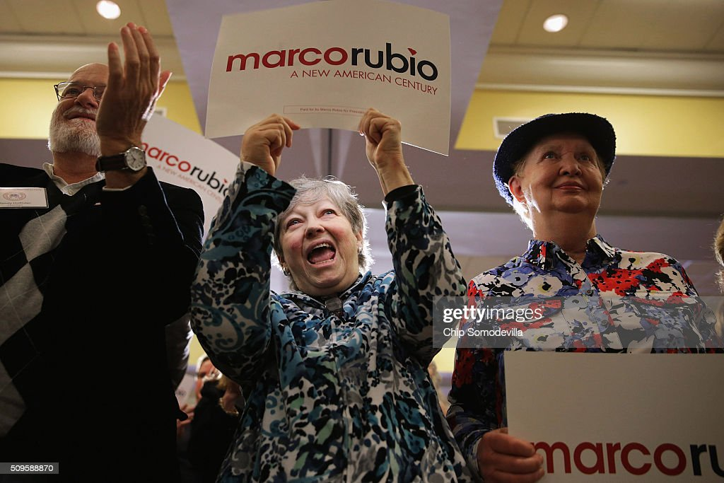 Randy Hollister, his wife Debbie Hollister and Beverly Gail cheer while listening to Republican presidential candidate Sen. Marco Rubio (R-FL) during a campaign town hall meeting at the Crown Reef Beach Resort February 11, 2016 in Myrtle Beach, South Carolina. Earlier in the week Rubio placed fifth in the New Hampshire primary, behind fellow GOP candidates Jeb Bush, John Kasich, Sen. Ted Cruz (R-TX) and Donald Trump, who won with 35 percent of the vote.