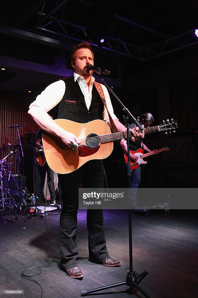 <a gi-track='captionPersonalityLinkClicked' href=/galleries/search?phrase=Randy+Houser&family=editorial&specificpeople=5348597 ng-click='$event.stopPropagation()'>Randy Houser</a> performs during the BBR Music Group 3rd annual Pre-CMA party at the Hard Rock Cafe Nashville on October 31, 2012 in Nashville, Tennessee.