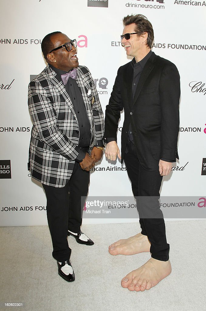 Randy Jackson (L) and Jim Carrey arrive at the 21st Annual Elton John AIDS Foundation Academy Awards viewing party held at West Hollywood Park on February 24, 2013 in West Hollywood, California.