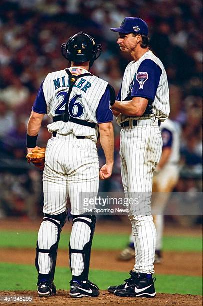 Randy Johnson and Damian Miller of the Arizona Diamondbacks during Game Two of the World Series against the New York Yankees on October 28 2001 at...