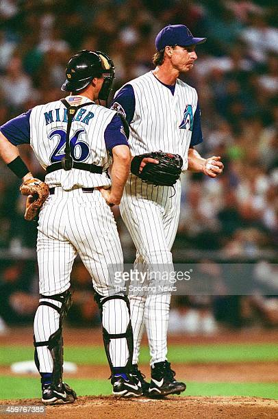 Randy Johnson and Damian Miller of the Arizona Diamondbacks talk on the mound during Game Six of the World Series against the New York Yankees on...