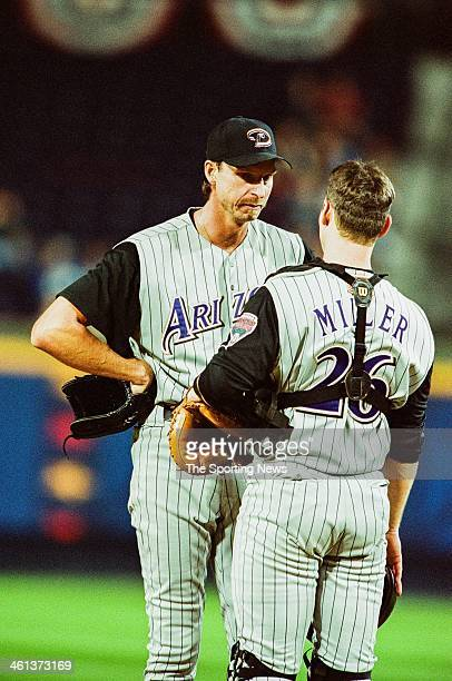 Randy Johnson and Damian Miller of the Arizona Diamondbacks talk on the field during Game Five of the National League Championship Series against the...