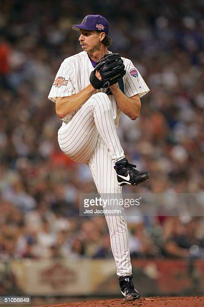 Randy Johnson of the National Team throws a pitch during the third inning of the Major League Baseball 75th AllStar Game at Minute Maid Park on July...