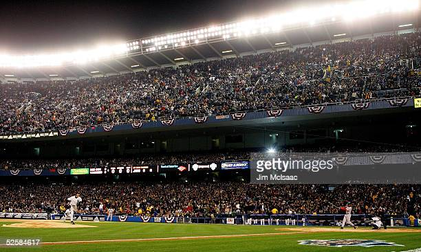 Randy Johnson of the New York Yankees throws the first pitch of the night against the Boston Red Sox during the Yankee's home opener at Yankee...