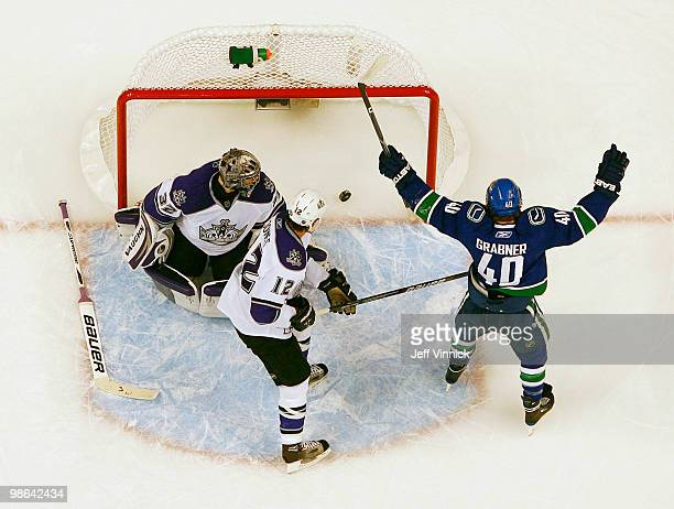 Randy Jones and Jonathan Quick of the Los Angeles Kings look on as Michael Grabner of the Vancouver Canucks celebrates a goal in Game Five of the...