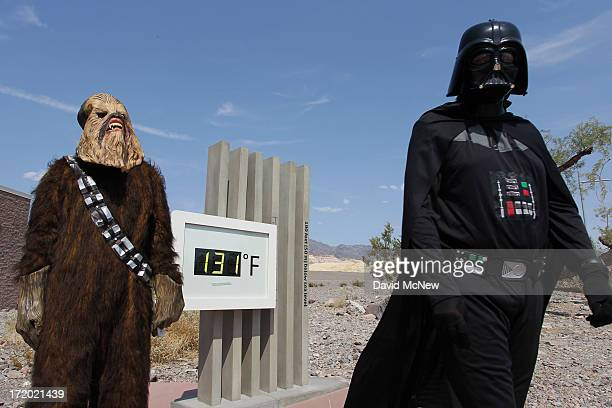 Randy Kern and John Rice dress as Star Wars characters for their own annual snapshot tradition near an unofficial thermometer at Furnace Creek...