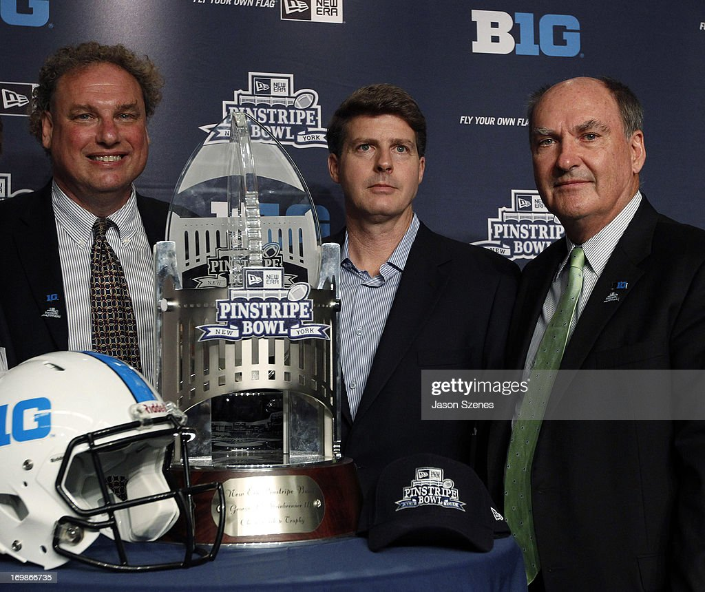 Randy Levine, President of the New York Yankees (L), Hal Steinbrenner, Managing General Partner of the New York Yankees (C) and Jim Delany, Commissioner of the Big Ten Conference pose with the New Era Pinstripe Bowl trophy during a press conference to announce the New Era Pinstripe Bowl's eight-year partnership with the Big Ten Conference at Yankees Stadium on June 3, 2013 in the Bronx borough of New York City. (Photo by Jason Szenes/Getty Image