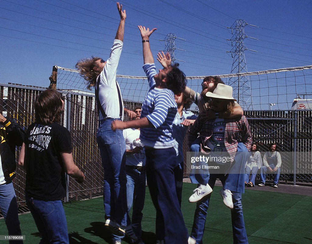 Randy Meisner and Don Felder of Eagles promoter Bill Graham and guests play volleyball at Day On The Green concert featuring Eagles at Oakland...
