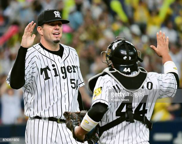 Randy Messenger of the Hanshin Tigers celebrates as he got the season's 11th win by beating the Yakult Swallows 30 at Kyocera Dome Osaka ==Kyodo