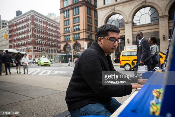 Randy Naraine a network engineer at J Crew stops and plays a piano outside the Astor Place subway stop near his work on June 5 2015 in New York City...