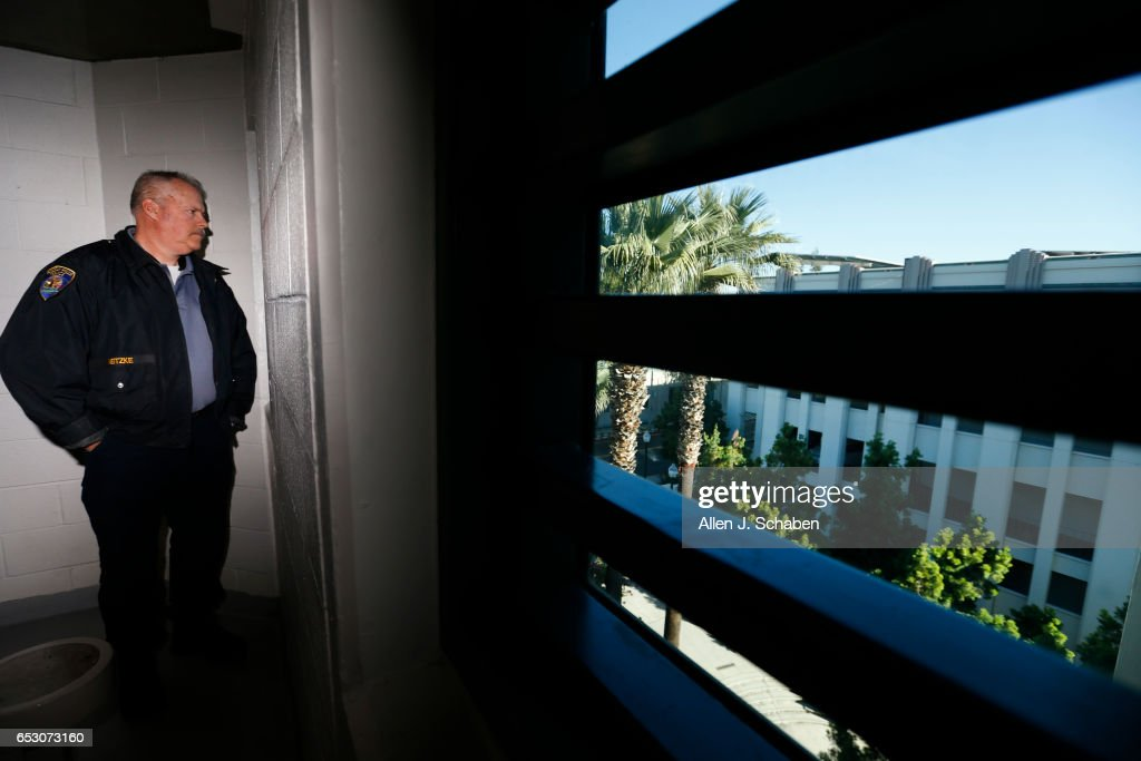 HILLS, CALIF. -- TUESDAY, JANUARY 17, 2017: Randy Neitzke, Beverly Hills Police jail supervisor looks out the window of the women's pay to stay jail cell dorm. The Beverly Hills Police Department offers a court commitment ââ¬ÅPay to Stayââ¬Â program, an alternative to serving time in a county jail facility. The sentencing Court must approve the individual to be eligible for the 'pay to stay' program. A jail sentence served in a pay to stay program is viewed as a safe, clean, and secure alternative to county jail. Photo taken in Beverly Hills, Calif., on Jan. 17, 2017.