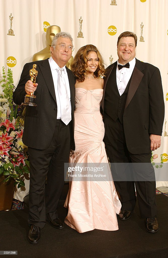 Randy Newman with the award for Achievement in Music Original Song 'If I Didn't Have you' from MONSTERS, INC. and John Goodman backstage at the 74th Annual Academy Awards held at the Kodak Theatre in Hollywood, Ca., March 24, 2002. 2002ImageDirect