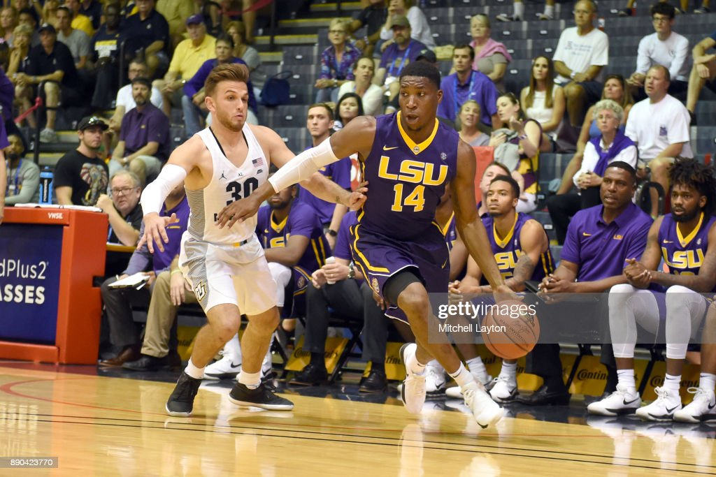 Randy Onwuasor #14 of the LSU Tigers dribbles around Andrew Rowsey #30 of the Marquette Golden Eagles during a consultation college basketball game at the Maui Invitational at the Lahaina Civic Center on November 22, 2017 in Lahaina, Hawaii. The Golden Eagles won 94-84.