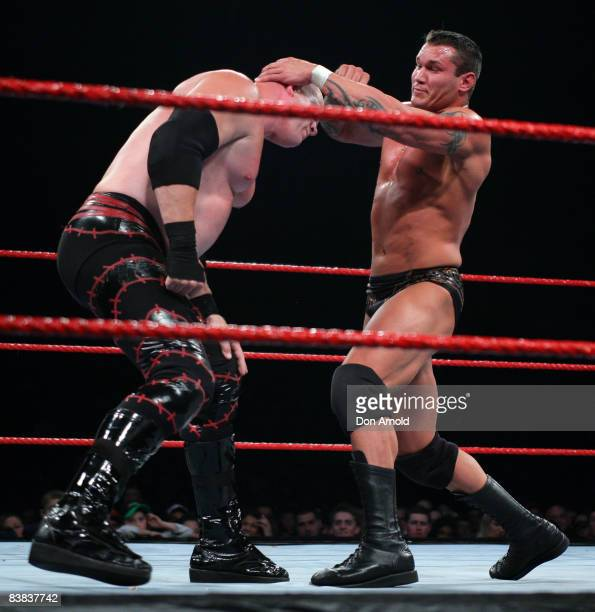 Randy Orton directs his energies towards the bald pate of Kane during the WWE RAW Superslam event at Acer Arena Homebush Stadium in Sydney on August...
