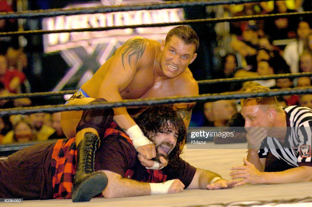 Randy Orton, Mick Foley and referee
