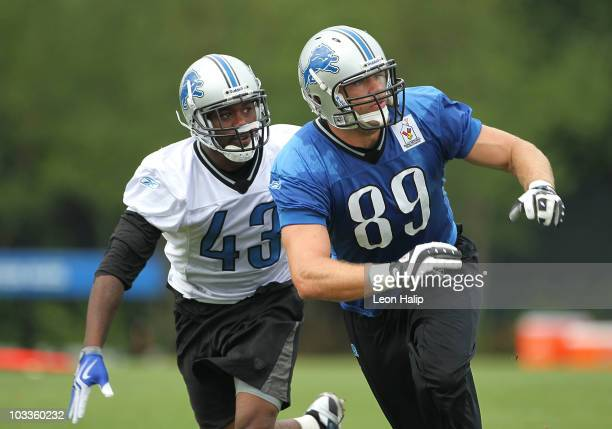 Randy Phillips and Will Heller of the Detroit Lions go through the morning drills during training camp at the Detroit Lions Headquarters and Training...