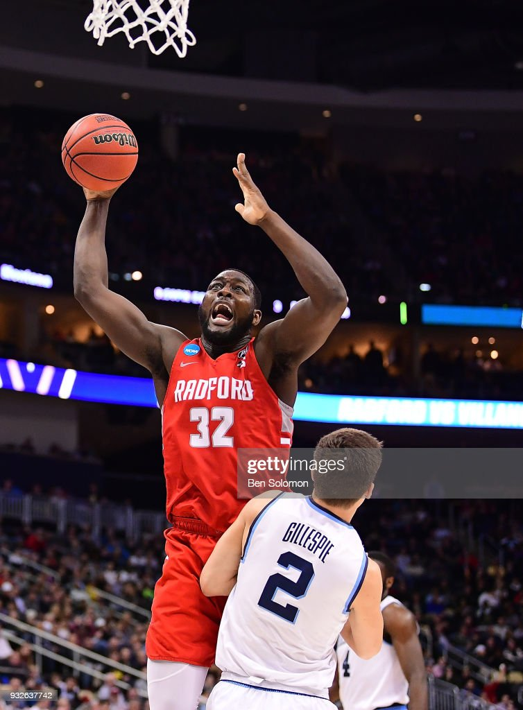Randy Phillips #32 of the Radford Highlanders goes to the basket against Collin Gillespie #2 of the Villanova Wildcats in the second half during the first round of the 2018 NCAA Men's Basketball Tournament held at PPG Paints Arena on March 15, 2018 in Pittsburgh, Pennsylvania.