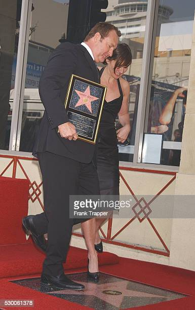 Randy Quaid and his wife Evi dance on his new star at the star ceremony honoring him on the Hollywood Walk of Fame