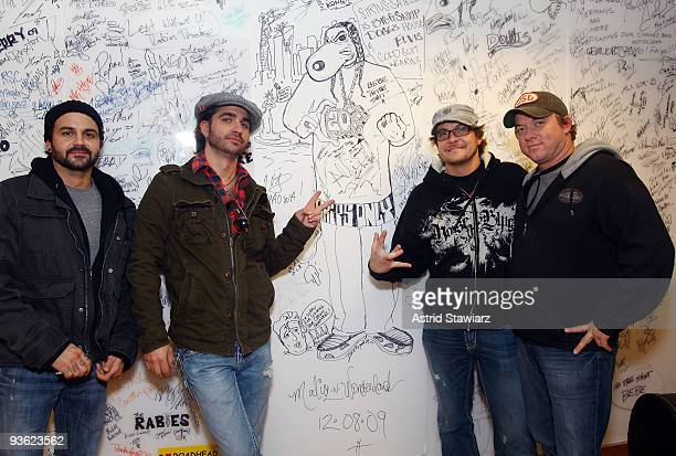 Randy Ragsdale Cody Canada Grady Cross and Jeremy Plato of the band Cross Canadian Ragweed pose for photos in front of a Snoop Dogg drawing at SIRIUS...