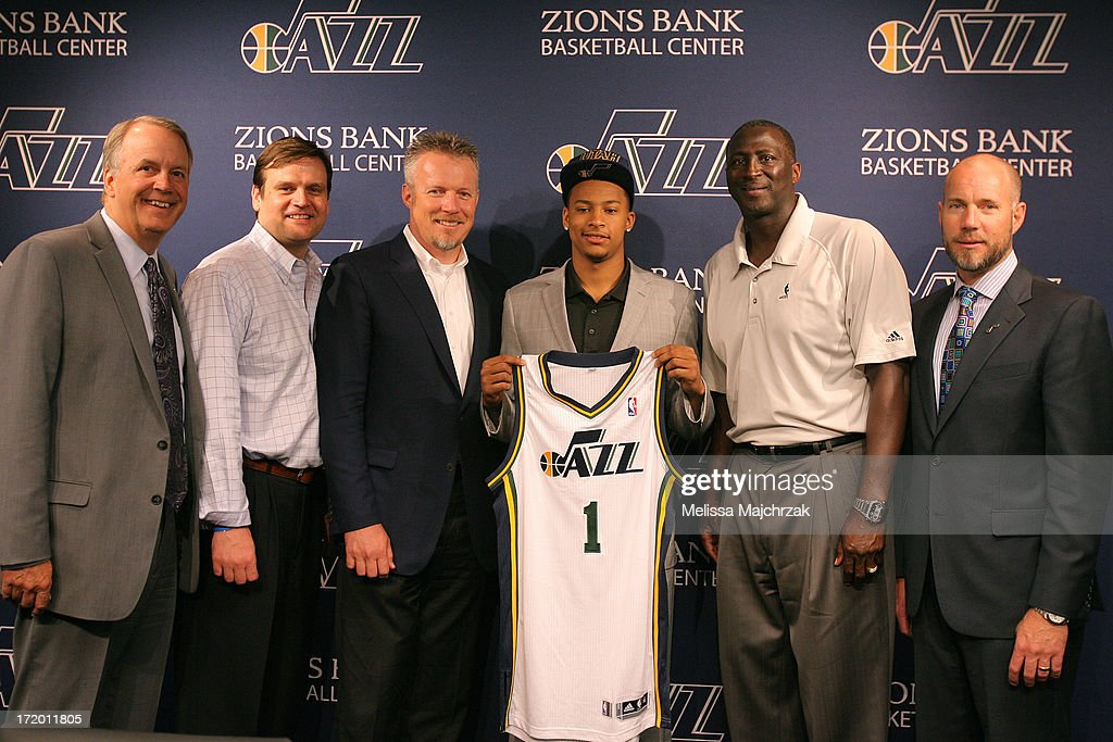 Randy Rigby President, Dennis Lindsey General Manager, Greg Miller CEO of Larry H. Miller Group of Companies, Trey Burke, Tyrone Corbin Head Coach of the Utah Jazz and Steve Miller President of Miller Motor Sports Properties pose for a photo after a press conference introducing the new draft picks of 2013 at Zions Bank Basketball Center on June 28, 2013 in Salt Lake City, Utah.