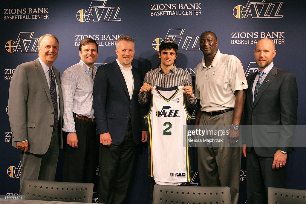 Randy Rigby President, Dennis Lindsey General Manager, Greg Miller CEO of Larry H. Miller Group of Companies, Raul Neto, Tyrone Corbin Head Coach of the Utah Jazz and Steve Miller President of Miller Motor Sports Properties pose for a photo after a press conference introducing the new draft picks of 2013 at Zions Bank Basketball Center on June 28, 2013 in Salt Lake City, Utah.