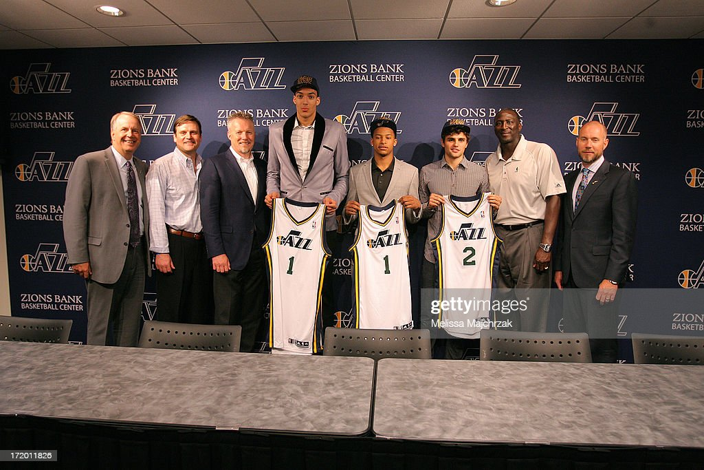 Randy Rigby President, Dennis Lindsey General Manager, Greg Miller CEO of Larry H. Miller Group of Companies, Rudy Gobert, Trey Burke, Raul Neto, Tyrone Corbin Head Coach of the Utah Jazz and Steve Miller President of Miller Motor Sports Properties pose for a photo after a press conference introducing the new draft picks of 2013 at Zions Bank Basketball Center on June 28, 2013 in Salt Lake City, Utah.