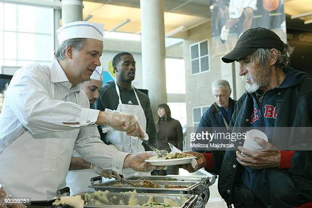 Randy Rigby President of the Utah Jazz serves food at the We Care We Share a Thanksgiving dinner celebration for Salt Lake's homeless and lowincome...