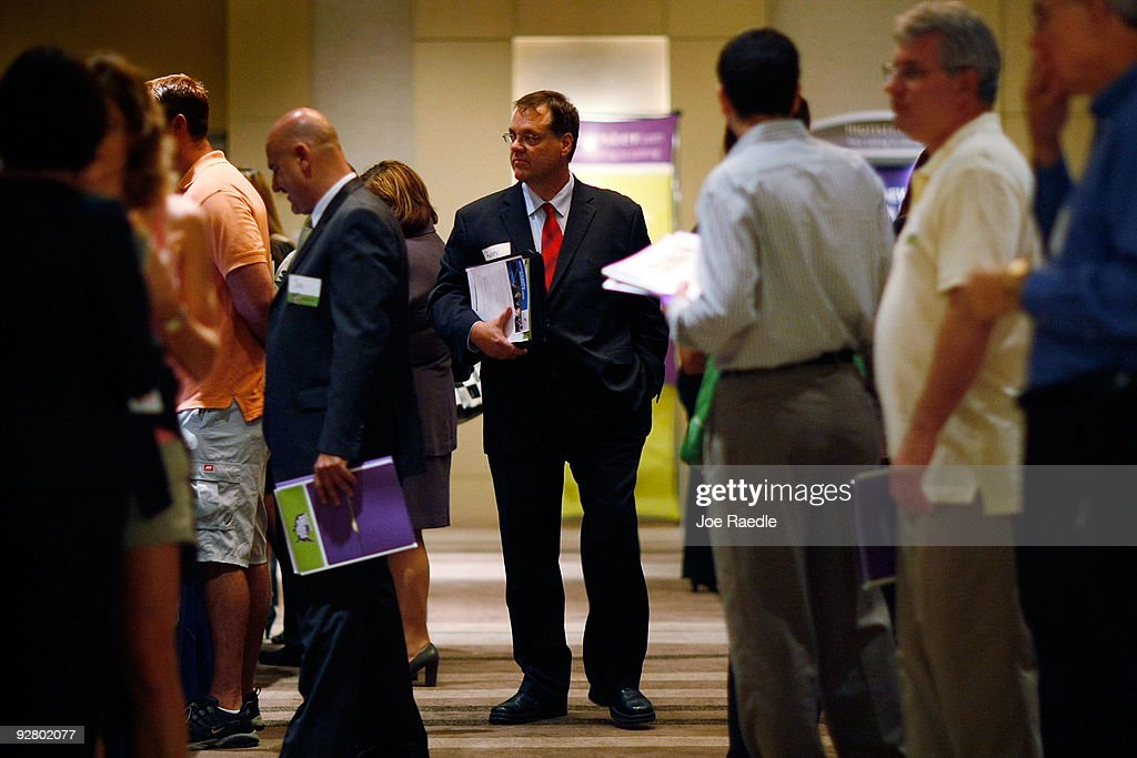 Randy Sirois (C) looks for work at a job fair put on by Monster.com on November 5, 2009 in Fort Lauderdale, Florida. The Monster's 'Keep America Working Tour', is helping workers find jobs as the US employment report for October, which comes out tomorrow, is expected to show that the jobless rate stayed close to a 26-year high of 9.8 per cent in September.