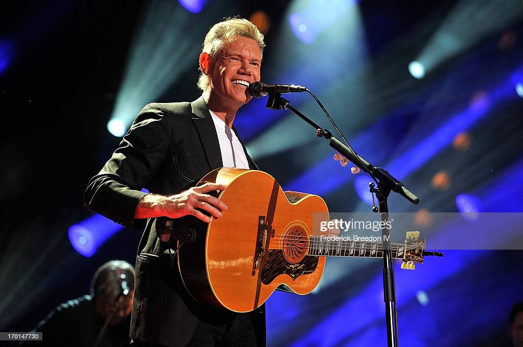 <a gi-track='captionPersonalityLinkClicked' href=/galleries/search?phrase=Randy+Travis&family=editorial&specificpeople=208114 ng-click='$event.stopPropagation()'>Randy Travis</a> performs at LP Field during the 2013 CMA Music Festival on June 7, 2013 in Nashville, Tennessee.