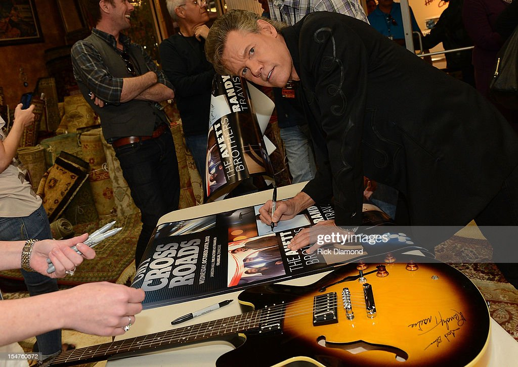 Randy Travis signs during CMT Crossroads: The Avett Brothers And Randy Travis tape at The Factory, Liberty Hall in Franklin, Tennessee on October 24, 2012 The Avett Brothers And Randy Travis airs only on CMT November 23rd 2012