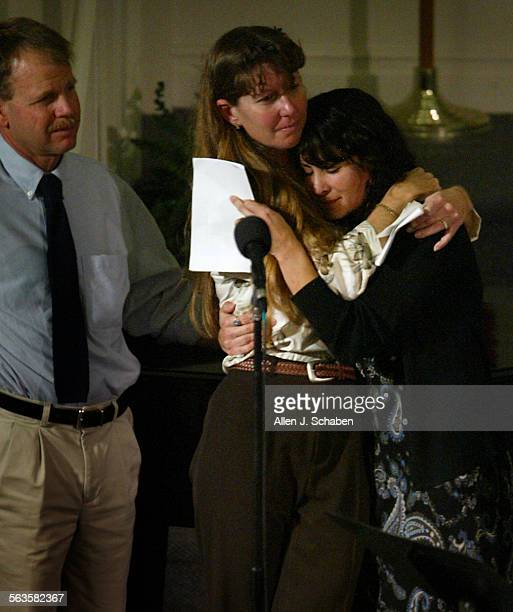 Randy Wilson left Melissa Fletcher middle and Marissa Brand right all of San Diego comfort each other after speaking about the good memories of...